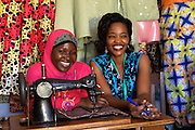 """Rahab Mbuba (right) with one of her sewing students.<br /> <br /> Rahab, also known as 'Mama B"""", set up and now runs a tailoring business, designing and making clothes.<br /> <br /> She attended MKUBWA enterprise training run by the Tanzania Gatsby Trust in partnership with The Cherie Blair Foundation for Women."""