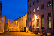 Street lights inside HMP/YOI Portland, a resettlement prison with a capacity for 530 prisoners. Dorset, United Kingdom.