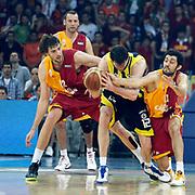 Galatasaray's Luksa ANDRIC (L),Tutku ACIK (R) and Fenerbahce's Darjus LAVRINOVIC (C) during their Turkish Basketball league Play Off Final fourth leg match Galatasaray between Fenerbahce Ulker at the Abdi Ipekci Arena in Istanbul Turkey on Saturday 11 June 2011. Photo by TURKPIX