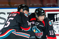 KELOWNA, CANADA - SEPTEMBER 22: Dallon Wilton #15 and Ted Brennan #10 of the Kelowna Rockets stretch on the ice during warm up against the Kamloops Blazers  on September 22, 2018 at Prospera Place in Kelowna, British Columbia, Canada.  (Photo by Marissa Baecker/Shoot the Breeze)  *** Local Caption ***