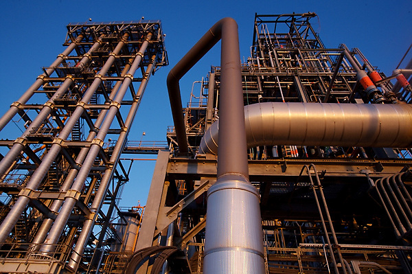 Stock photo of piping at a chemical plant at sunset