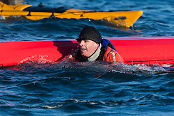 Scottish Sun sports editor Iain King capsizing in a practise session for his charity kayak challenge, in the waters of the harbour at St Abbs..Pic © Michael Schofield...