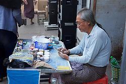 Marketer Using Cell Phone Near Gyee Zai Market