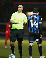 Referee Bobby Madley urges Ollie Rathbone of Rochdale (14)  to calm down  during the EFL Sky Bet League 1 match between Rochdale and Wigan Athletic at the Crown Oil Arena, Rochdale, England on 16 January 2021.