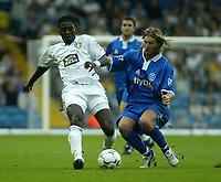 Photo. Andrew Unwin<br /> Leeds United v Birmingham City, Barclaycard Premier league, Elland Road, Leeds 20/09/2003.<br /> Birmingham City's Robbie Savage (r) challenges Leeds' Lamine Sakho (l) for the ball.