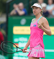 NOTTINGHAM, ENGLAND - JUNE 13: Mona Barthel of Germany pumps her fist after winning a point against Magdalena Rybarikova of Slovakia during Day Five of the Nature Valley Open at Nottingham Tennis Centre on June 13, 2018 in Nottingham, United Kingdom.