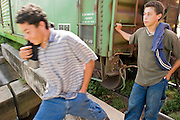 07 OCTOBER 2003 -- TAPACHULA, CHIAPAS, MEXICO:  People from Central America wait in the train yards in the Mexican town of Hidalgo, near Tapachula, hoping to hop the freight trains north on their way to the US. Tapachula is center of the smuggling industry between Mexico and Guatemala. Consumer goods are smuggled south to Guatemala (to avoid paying Guatemalan import duties) and people are smuggled north into Mexico. Most of the people coming north are hoping to eventually get to the United States.   PHOTO BY JACK KURTZ