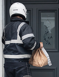 © Licensed to London News Pictures. 13/02/2020. London, UK. A delivery of take-away food from 'Five Guys' arrives at the Fulham home of former chancellor Sajid Javid.  Sajid Javid has resigned as chancellor during the cabinet reshuffle. Photo credit: Peter Macdiarmid/LNP