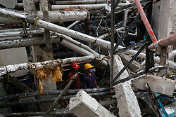 July 4, 2017 - Dhaka, Bangladesh - Bangladeshi workers busy to search and rescue operation at a destroyed garment factory in Gazipur on July 4, 2017, after a boiler explosion at the complex on the outskirts of Dhaka. Fire Service and Civil Defense (FSCD) Assistant Director Akteruzzaman confirmed the death toll now stands at 11 and Over 50 people were injured in the boiler blast at Multifabs Limited, a four-storey apparel factory in Gazipur. (Credit Image: © Mehedi Hasan/NurPhoto via ZUMA Press)