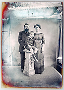 vintage daylight studio family portrait with background retouching markings on deteriorating glass plate