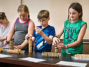 27 JUNE 2019 - CENTRAL CITY, IOWA: AARON QUAAS, 10, middle, and others stack sandwich cream cookies during the cooking stacking contest at the Linn Fair. Summer is county fair season in Iowa. Most of Iowa's 99 counties host their county fairs before the Iowa State Fair, August 8-18 this year. The Linn County Fair runs June 26 - 30. The first county fair in Linn County was in 1855. The fair provides opportunities for 4-H members, FFA members and the youth of Linn County to showcase their accomplishments and talents and provide activities, entertainment and learning opportunities to the diverse citizens of Linn County and guests.         PHOTO BY JACK KURTZ