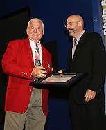 28 August 2006: Al Trost (l) is presented with his Hall of Fame jacket, plaque, and ring by HOF president Will Lunn during his induction. The National Soccer Hall of Fame Induction Ceremony was held at the National Soccer Hall of Fame in Oneonta, New York.