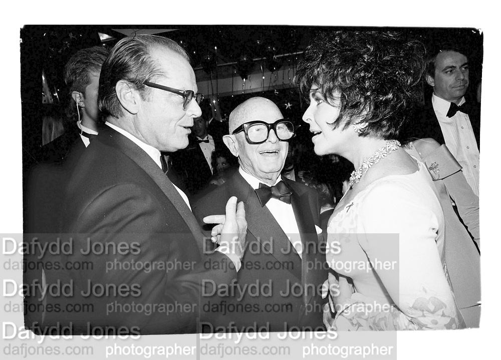 Jack Nicholson, Swifty Lazar and Elizabeth Taylor at Swifty's last Oscar Night  Party. Spago's. Los Angeles. March 1993. Film. 93237/8<br /><br />© Copyright Photograph by Dafydd Jones<br />66 Stockwell Park Rd. London SW9 0DA<br />Tel 0171 733 0108