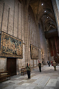 Interior hanging tapestries in Narbonne Cathedral in Narbonne, France. Cathedrale Saint-Just-et-Saint-Pasteur de Narbonne, is a Gothic style Roman Catholic church located in the town of Narbonne, France. The cathedral is a national monument and dedicated to Saints Justus and Pastor.