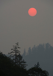 September 6, 2017 - Elton, OREGON, U.S - The sun is turned red by a thick layer of wildfire smoke as it rises as seen from near Elkton in western Oregon. Numerous large wildfires are burning in the Pacific Northwest and causing severe our quality issues. (Credit Image: © Robin Loznak via ZUMA Wire)