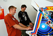 """Google interns Sid Stamm and Jacob Ratkiewicz, both from Bloomington, Indiana, play """"Space Duel"""" at the Googleplex campus in Mountain View, Calif. on May 15, 2007. (Photo by Jakub Mosur/For Boston Globe)"""