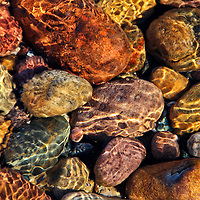 """""""Underwater Treasure<br /> <br /> The underwater glimmer of beautiful weather worn stones of Lake Superior! Shimmering in the water from the bright sun shining above!!<br /> Brilliant colors of rust, orange, blue, yellow, gold, red, pink,and gray smooth stones sparkle like treasure in the shallow waters below!!<br /> <br /> Nature Abstracts by Rachel Cohen"""