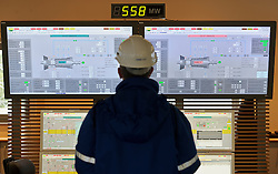 """An RWE employee monitors the two main generators, affectionately named """"Elisa"""" and """"Emily"""", in the control room at the RWE gas burning power plant, in Lingen, Germany, on Tuesday, Sept. 6, 2011. (Photo © Jock Fistick)"""