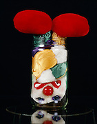 clown doll stuffed in a jar