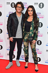 Amber Davies and Kem Cetinay attending the BBC Radio 1 Teen Wards, at Wembley Arena, London. Picture date: Sunday October 22nd, 2017. Photo credit should read: Matt Crossick/ EMPICS Entertainment.