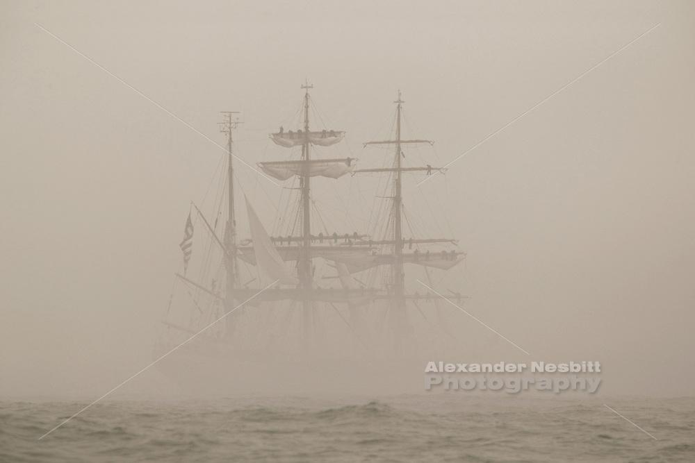 Tallship 'Eagle' dissappears into fog, tallships 2004 parade of sail, Newport, RI, USA