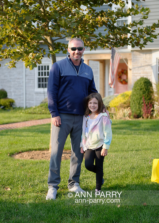 Rockville Centre, New York, U.S. September 22, 2020. L-R, MAEVE SCHIELE, 7, and her father BRIAN SCHIELE are standing in front of their home, where Ruth Bader and Martin Ginsburg were married in 1954. The Schiele family bought the Colonial home on Long Island in 2016, from Martin Ginsburg's sister and brother-in-law, Claire and Edward Steipleman.
