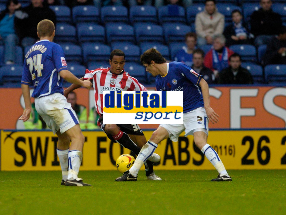 Photo: Leigh Quinnell.<br /> Leicester City v Southampton. Coca Cola Championship.<br /> 05/11/2005. Southamptons Theo Walcott cant find a way past Leicesters Patrick McCarthy and Patrik Gerrbrand.