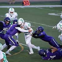 Patriots Tyler Haws #3, and Trey Keeler #7 work together to bring down Bulldogs Alexander Ortiz #27 who returned the opening kickoff for the second half. Miyamura High School played against the Albuquerque Bulldogs Saturday night in a losing effort. The Bulldogs won 35-20 in Gallup, NM.