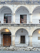 The robust stone colonnades of the 18th century El Ayuntamiento, the town hall, building on the north side of Parque Central. Antigua Guatemala, Republic of Guatemala. 02Mar14