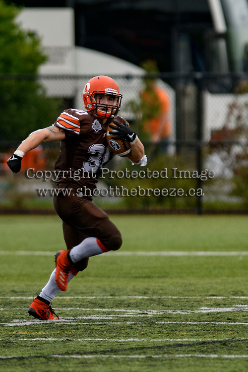 CHILLIWACK, BC - SEPTEMBER 11: Tristan Peddle #30 of Okanagan Sun runs with the ball against Westshore Rebels at Exhibition Stadium in Chilliwack, BC, Canada. (Photo by Marissa Baecker/Shoot the Breeze)