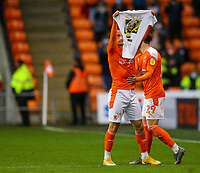 Blackpool's Jerry Yates celebrates scoring his side's third goal by holding up a shirt in tribute to young Blackpool boy Jordan Banks<br /> <br /> Photographer Alex Dodd/CameraSport<br /> <br /> The EFL Sky Bet League One Play-Off Semi-Final 2nd Leg - Blackpool v Oxford United - Friday 21st May 2021 - Bloomfield Road - Blackpool<br /> <br /> World Copyright © 2021 CameraSport. All rights reserved. 43 Linden Ave. Countesthorpe. Leicester. England. LE8 5PG - Tel: +44 (0) 116 277 4147 - admin@camerasport.com - www.camerasport.com