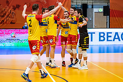 Dynamo celebrate after win in second set during the cupfinal between Amysoft  Lycurgus vs. Draisma Dynamo on April 18, 2021 in sports hall Alfa College in Groningen
