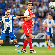 BARCELONA, SPAIN - August 18:  Facundo Ferreyra #9 of Espanyol and Daniel Carrico #6 of Sevilla challenge for the ball during the Espanyol V  Sevilla FC, La Liga regular season match at RCDE Stadium on August 18th 2019 in Barcelona, Spain. (Photo by Tim Clayton/Corbis via Getty Images)