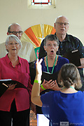 Local choir, the People Who Care choir performing in the Wesley Chapel, Guildford, as part of the 2018 Guildford Songfest