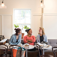 Friends share a laugh while dining and studying at Old World Levain Bakery (OWL), a bakery and coffee shop owned by Susannah Gebhart,  located at 295 Haywood Road in the West Asheville neighborhood of Asheville, North Carolina.