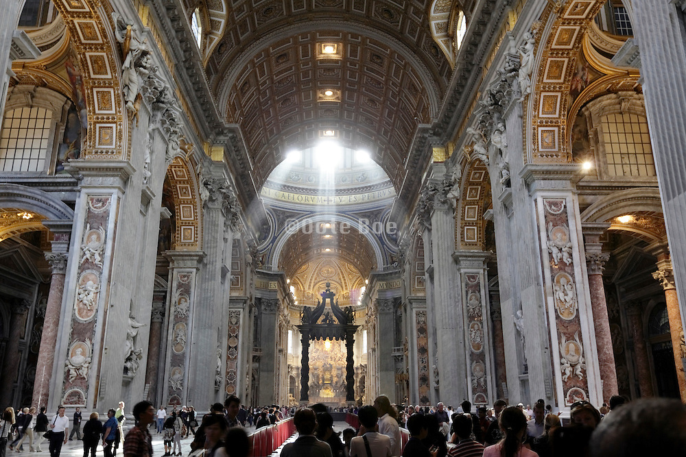 dramatic ray of light inside central nave at Saint Peters in Rome