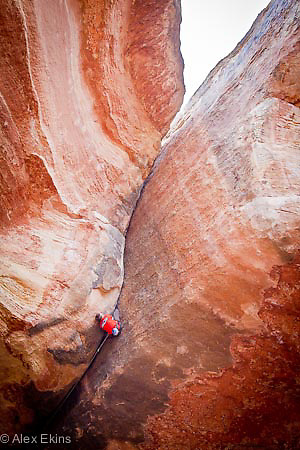 British rock climber Pete Whittaker on his ascent of 'Century Crack' in Canyonlands, Utah. Graded 5.14b or 8c, this is the hardest off-width rock climb in the world.