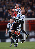 Claus Jensen (Charlton) Jermaine Jenas and Gary Speed (Newcastle) all jump for the ball. Charlton v Newcastle, The Valley, 20/12/2003, Premiership Football. Credit : Colorsport / Robin Hume. Digital File Only.