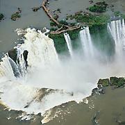 South America, Argentina, Brazil, Igwazu, Foz, Falls. Igwacu Falls thunder into the River Igwacu  below.