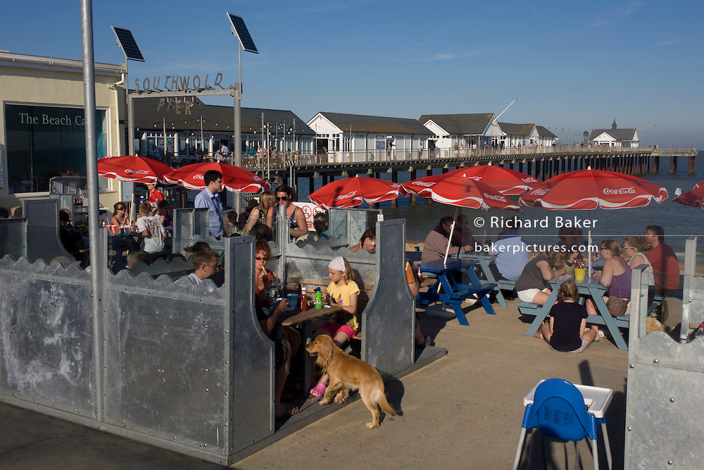 Evening fish and chip diners on the coast at the Suffolk seaside town of Southwold, Suffolk.