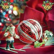 Flies and Santa under the Christmas tree.