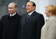 Moscow, Russia, 09/05/2005..Russian President Vladimir Putin and wife Ludmilla greet Italian Prime Minister Silvio Berlusconi at the Kremlin before the parade in Red Sqaure marking the 60th anniversary of victory in the Great Patriotic War.