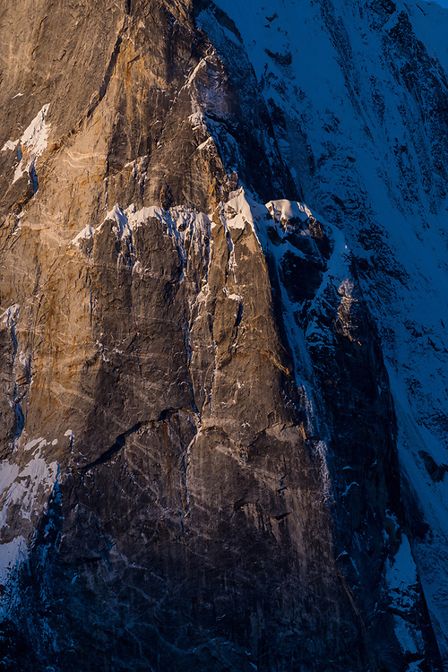 Quentin Roberts and Juho Knuuttila at sunrise on the North Pillar of Teng Kang Poche after spending the night in an open bivy, Nepal