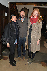 Left to right, BEATRIX ONG, PETER DAVIES and OLIVIA INGE at the Quintessentially Foundation and The Crown Estate's Fayre of St.James' on 27th November 2014.  The evening started with a christmas concert at St.James's Church, Piccadilly.  Following the concert singer Leona Lewis switched on the Jermyn Street Christmas lights and then guests had a party at the newly refurbished Quaglino's, 16 Bury Street, London