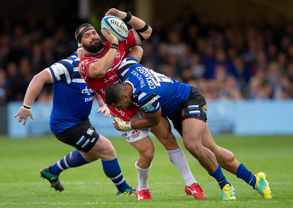 Gloucester Rugby's James Hanson is tackled by Bath Rugby's Joe Cokanasiga<br /> <br /> Photographer Bob Bradford/CameraSport<br /> <br /> Gallagher Premiership - Bath Rugby v Gloucester Rugby - Saturday September 8th 2018 - The Recreation Ground - Bath<br /> <br /> World Copyright © 2018 CameraSport. All rights reserved. 43 Linden Ave. Countesthorpe. Leicester. England. LE8 5PG - Tel: +44 (0) 116 277 4147 - admin@camerasport.com - www.camerasport.com