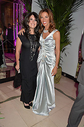 Left to right, MONICA LEWINSKI and HEATHER KERZNER at the QBF Spring Gala in aid of the Red Cross War Memorial Children's Hospital hosted by Heather Kerzner and Jeanette Calliva at Claridge's, Brook Street, London on 12th May 2015.
