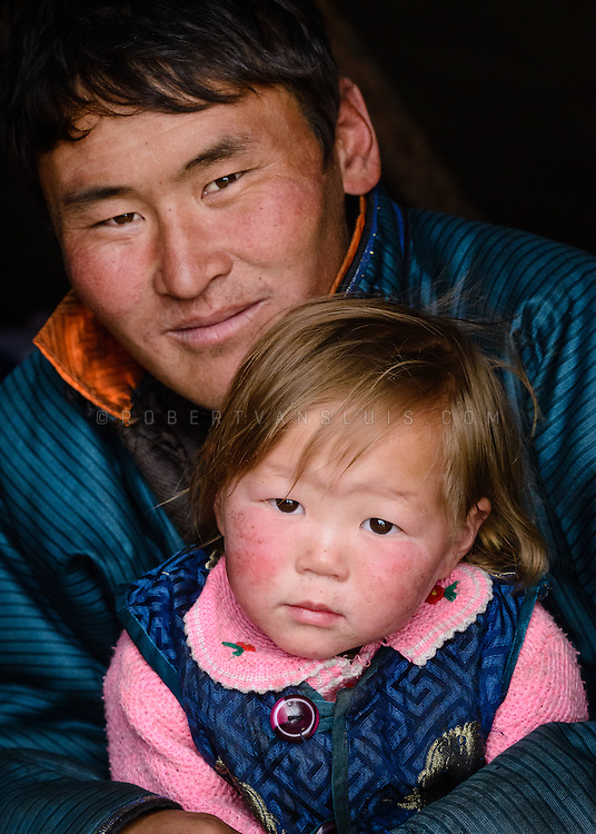 Member of the Dukha (Tsaatan) reindeer herder community with his son, Mongolia. Approximately 200 families comprise the Tsaatan or Dukha community in northwestern Mongolia, whose existence is intimately linked to their herds of reindeer. Photo © Robert van Sluis