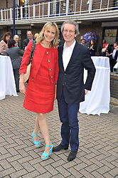 MR DAVID & the HON.MRS MONTGOMERY at a party to celebrate the launch of Bentley's The Collection held at 6 Square Rigger Row, Plantation Wharf, York Road, London SW11 on 25th June 2012.