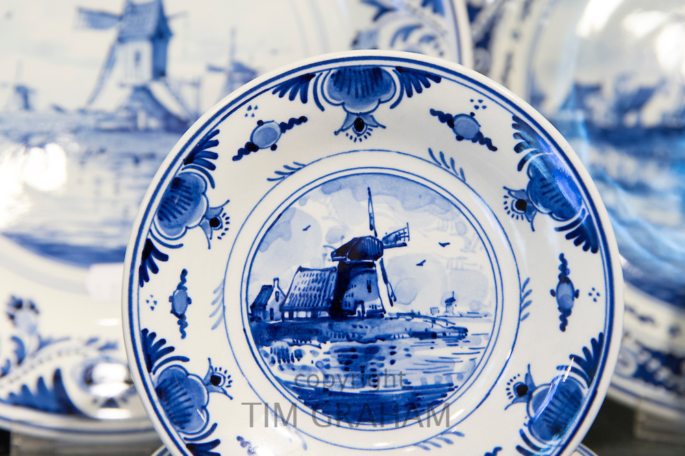 Delft Blue luxury items - traditional porcelain windmill plates - in Royal Delft Experience shop in Amsterdam, Holland