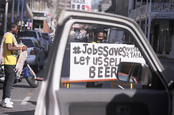 South Africa - Cape Town - 22 July 2020 - Restaurants, take-aways and coffee shops across the country toke to the streets  to draw attention to the devastating effects of lockdown regulations on the industry. Restaurants blocked the roads outside their premises by dragging all tables and chairs into the street. Photographer Ayanda Ndamane African News Agency(ANA)